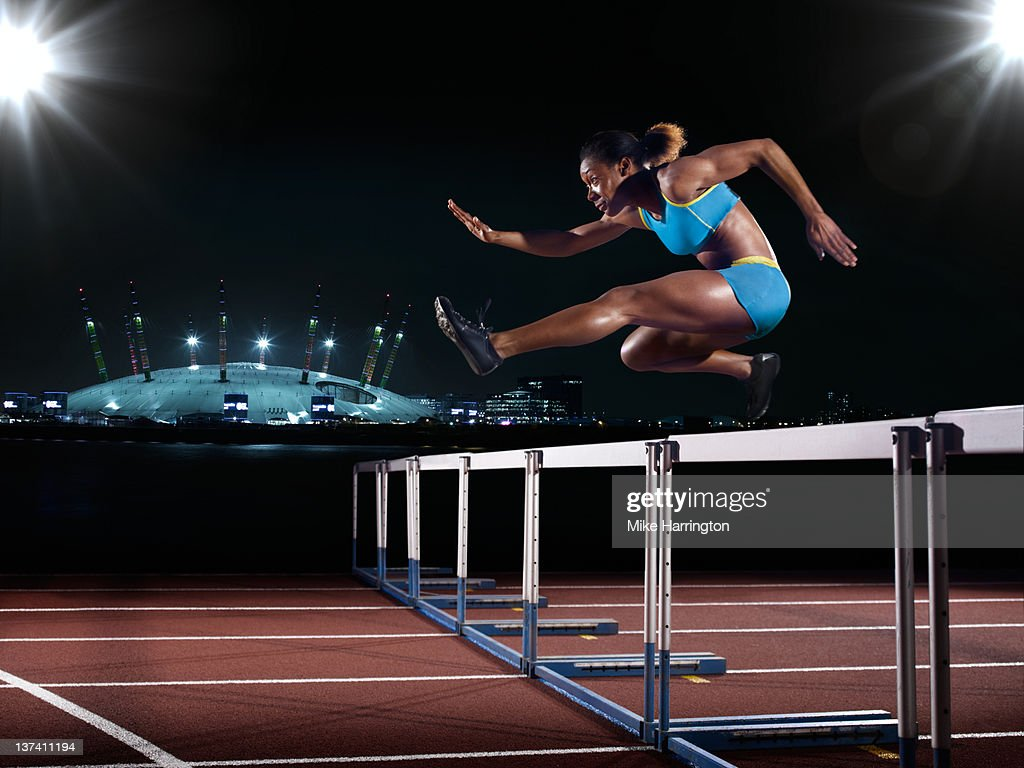 Female Hurdling In London : Stock Photo