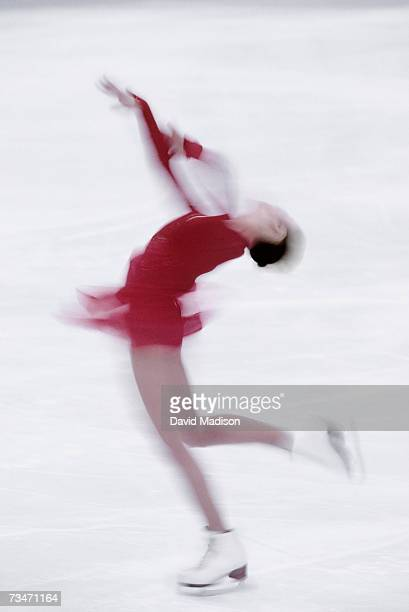 Female ice skater in a spin