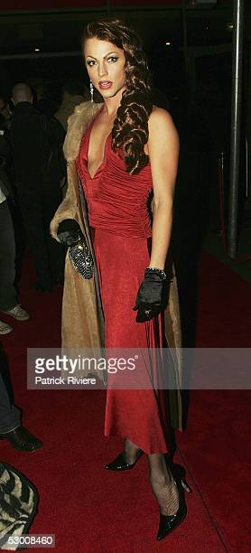 Female impersonator Courtney Act attends the opening night of 'Carlotta's Kings Cross' at the Big Top at Luna Park on June 01 2005 in Sydney Australia