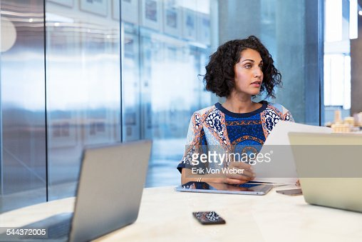 Female in discussion in conference room