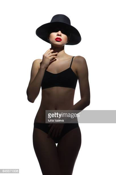 Female in hat and black lingerie