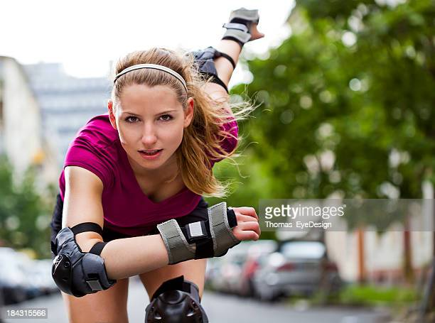 Female Inline Skater Working Out on a City Street