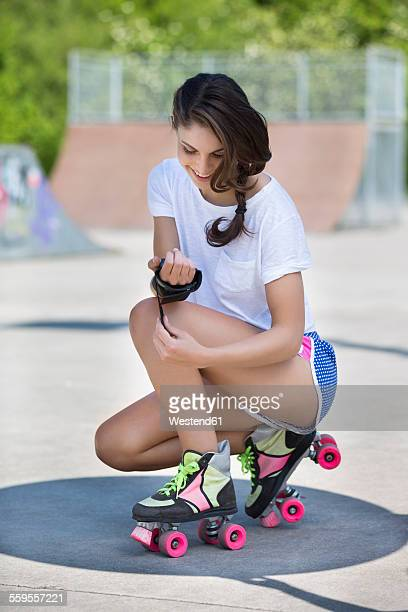 Female inline-skater with hand protection