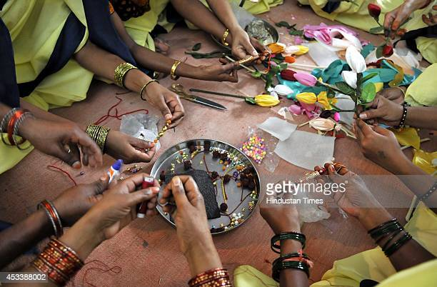 Female inmates busy in preparing decorative material gift itmes and rakhis at Indore District Jail on August 9 2014 in Indore India They have...