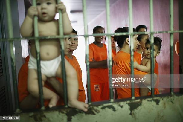 Female inmates gather with babies as they greet visitors in the Pedrinhas Prison Complex the largest penitentiary in Maranhao state on January 27...