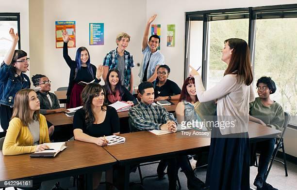 Female Instructor teaching high school class.