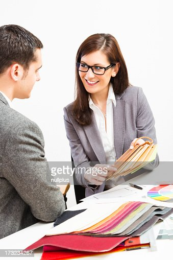 Female Interior Designer With Client Stock Photo Getty