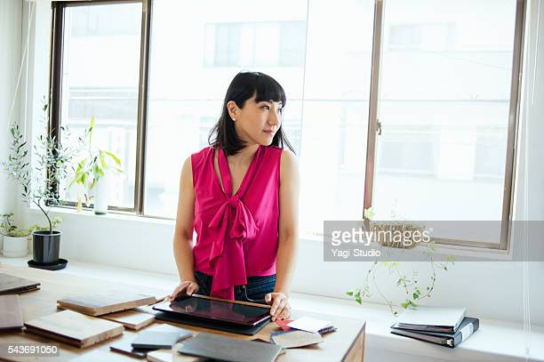 Female interior designer working in design studio
