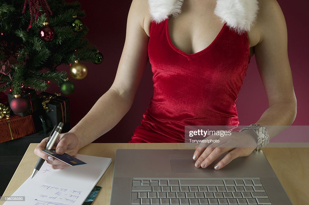 Female internet shopping at Christmas : Stock Photo