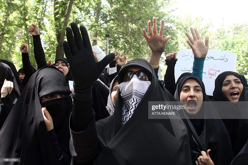 Female Iranian students shout slogans as they attend an anti-Israeli demonstration in front of the United Nations offices in Tehran, on May 6,2013, to condemn Israeli air strikes on targets near the Syrian capital Damascus. Israeli raids on Syrian targets at the weekend killed at least 15 soldiers, a watchdog said, as UN chief Ban Ki-moon led calls for restraint to prevent the war spilling over borders.