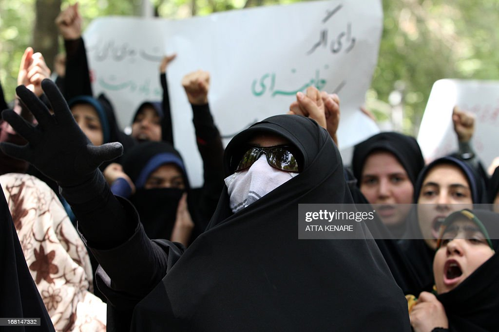 Female Iranian students shout slogans as they attend an anti-Israeli demonstration in front of the United Nations offices in Tehran, on May 6,2013, to condemn Israeli air strikes on targets near the Syrian capital Damascus. Israeli raids on Syrian targets at the weekend killed at least 15 soldiers, a watchdog said, as UN chief Ban Ki-moon led calls for restraint to prevent the war spilling over borders. AFP PHOTO/ATTA KENARE