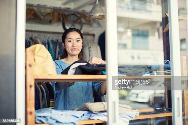 Female Japanese Resale Shop Owner in her Store