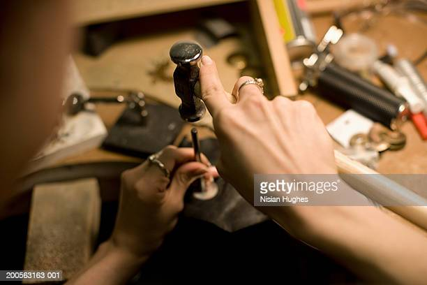 Female jeweller working in workshop, close-up