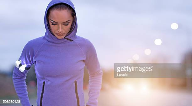 female jogger at winter evening outdoors