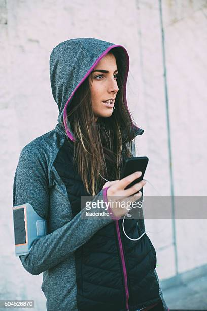 Female Jogger Using Phone