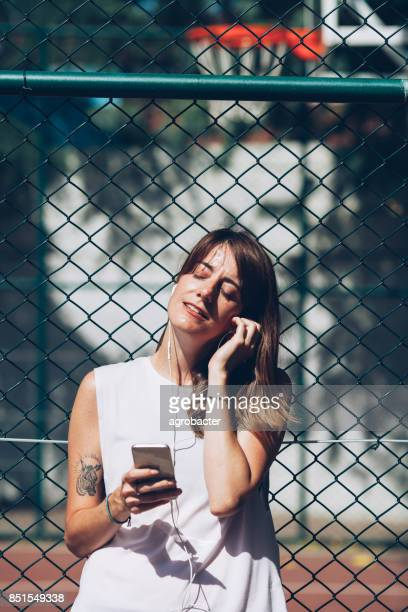 Female Jogger Using Phone