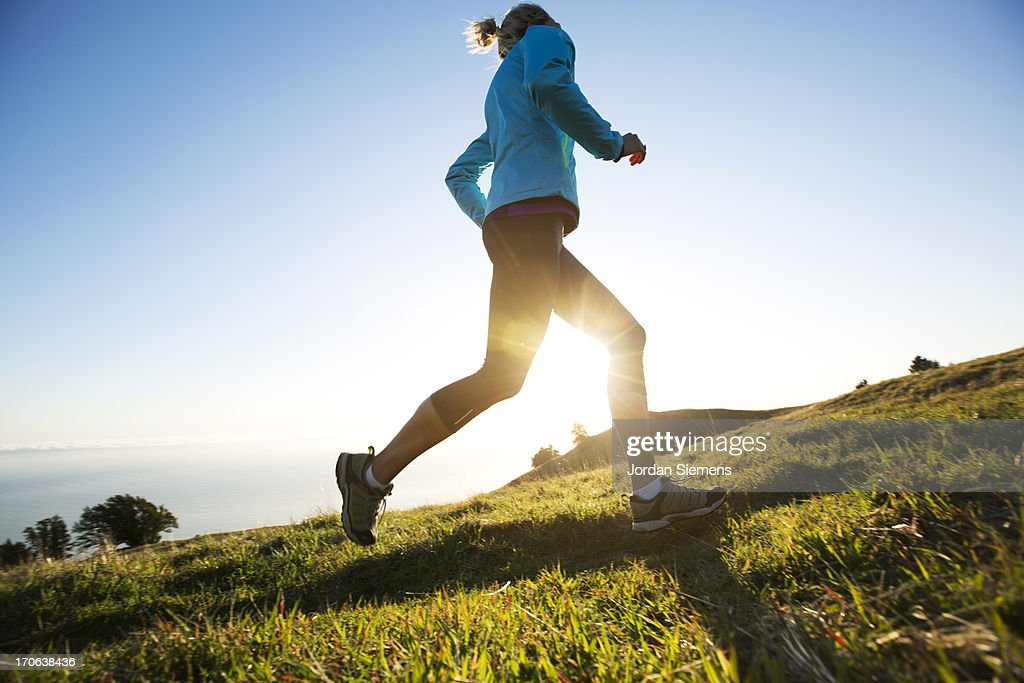 A female jogging for exercise. : Stock Photo