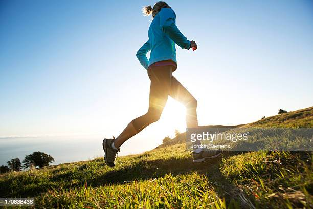 A female jogging for exercise.