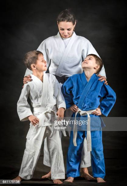 Female Judo Fighter With Little Disciples