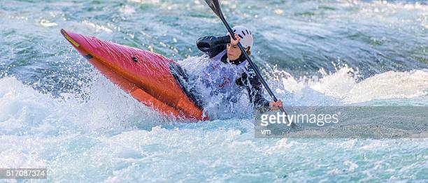 Female kayaker paddling in whitewater