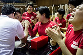 Female keirin students laugh after an arm wrestling match against their teacher during training at the Nihon Keirin Gakkou on July 8 2015 in Izu...