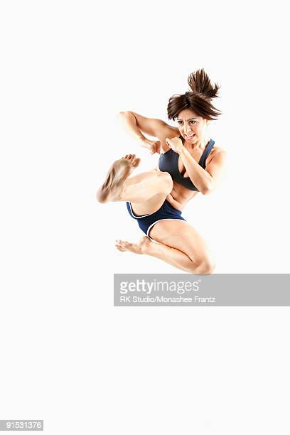 Female Kickboxer doing a 'High Jump Leg Punch'.