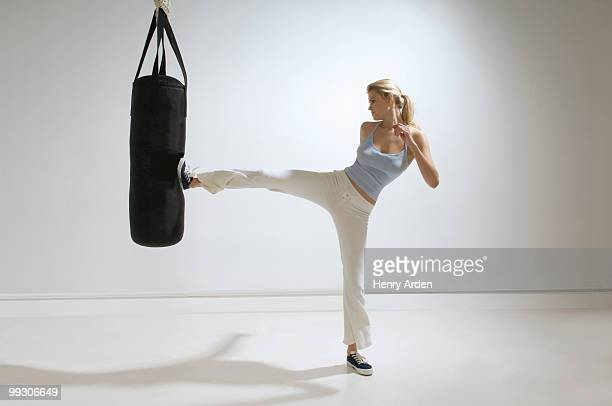Female kicking punchbag