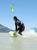 female kite boarder, on water