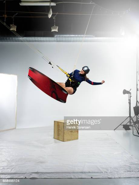 Female kitesurfer in a studio