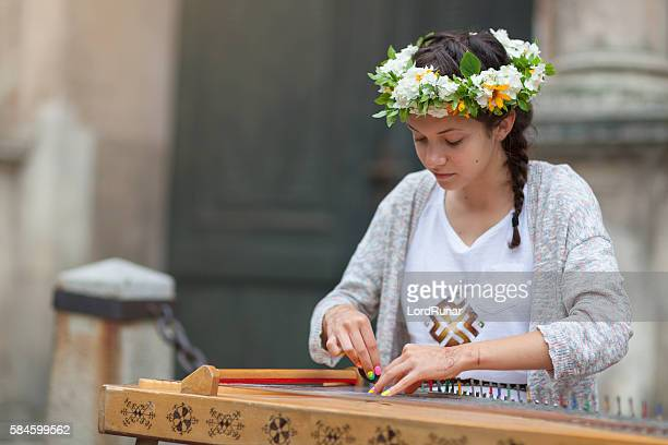 Female kokle player in Riga