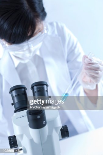 Female lab technician with a test tube : Stock Photo