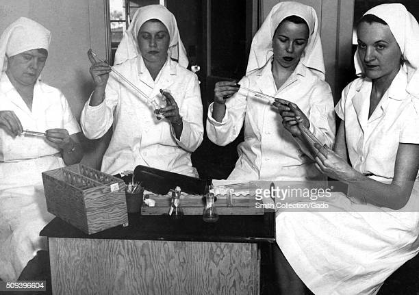Female laboratory technicians performing tests in the Virus and Rickettsia Laboratory Image courtesy CDC 1953