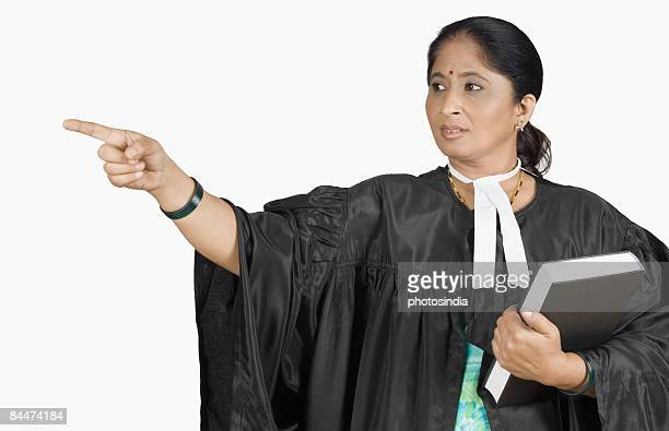 Female lawyer holding a book and pointing