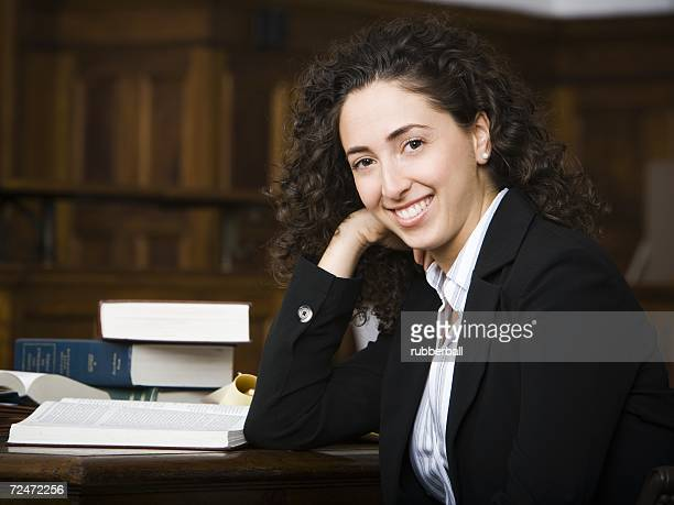 Female lawyer smiling in courtroom