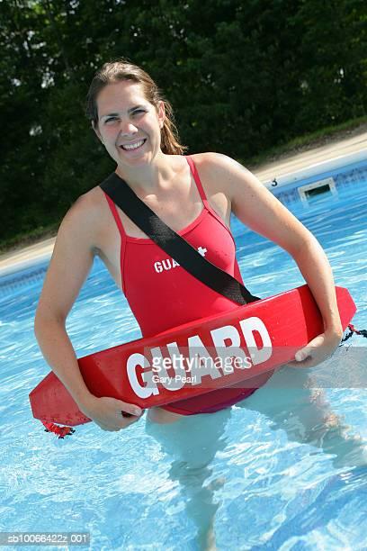 Female life guard in swimming pool, portrait