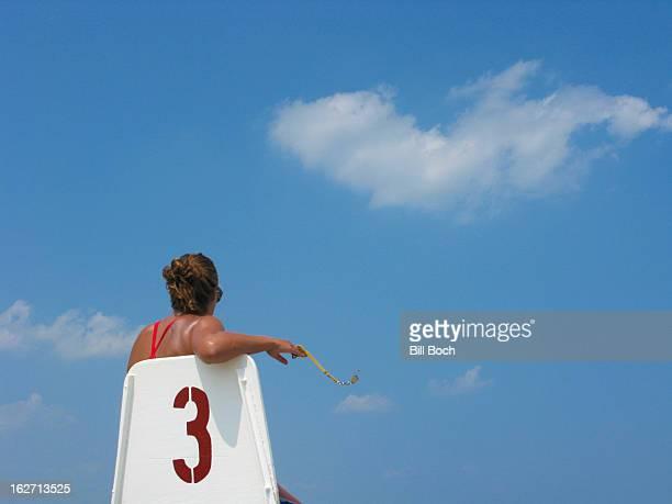 Female lifeguard in a chair