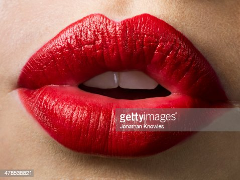 Female lips with red lipstick on, close up