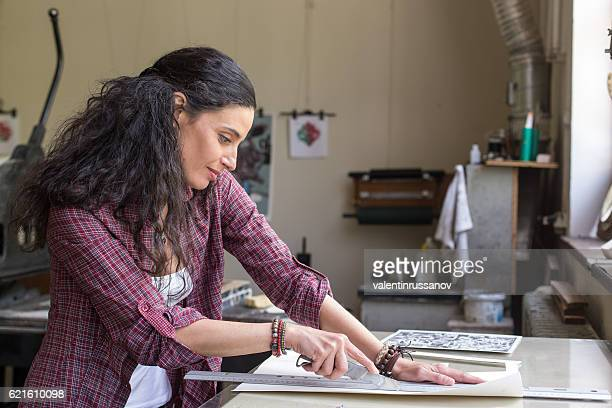 Female lithography worker at workshop