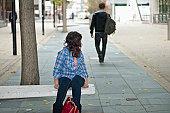 Female looking at male walking in street