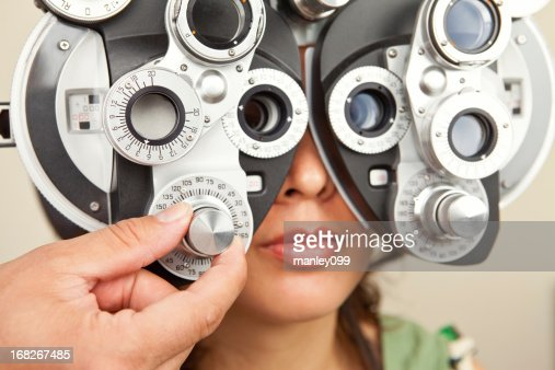 Female looking into diopter