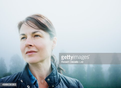 Female looking to horizon in rural scene
