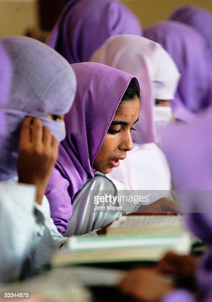 Female madrassa students study verses of the Koran during class on August 4 2005 in Multan Pakistan According to the Pakistani government a million...