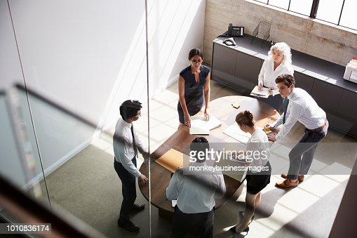 Female manager and business team in meeting, elevated view : Foto de stock