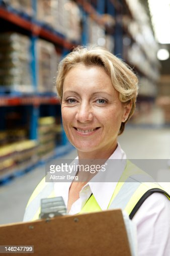 Female manager in a food distribution warehouse : Stock Photo