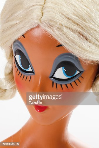 Female mannequin head wearing blonde wig with plaits : Stock Photo