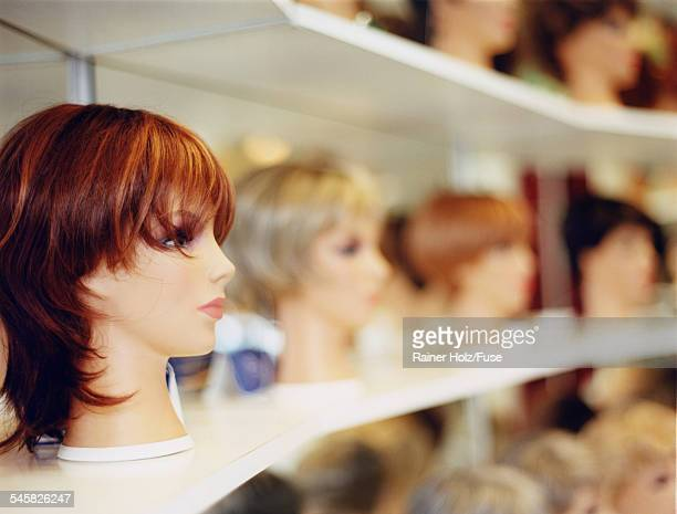 Female mannequin heads wearing wigs