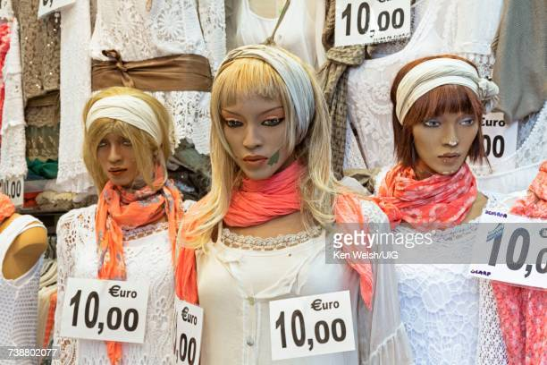 Female mannequins with prices attached.