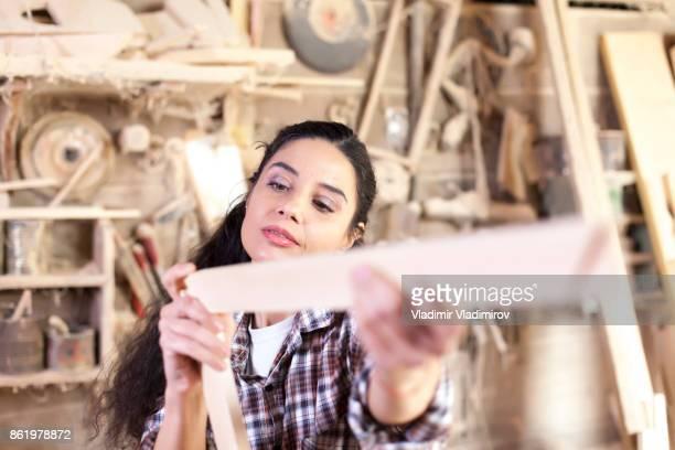 Female manual worker in workshop