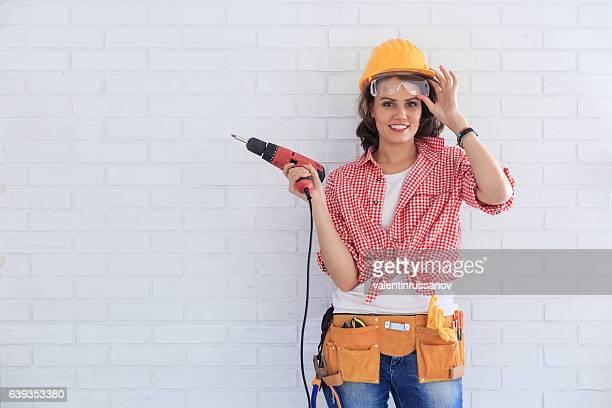 Female manual worker using screwdriver