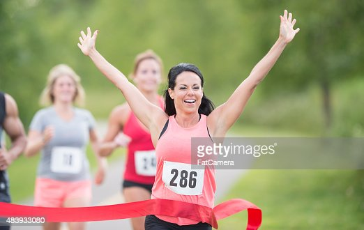 Female marathon runner winning race